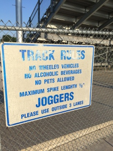 "Funny sign at Wellsville HS. ""Joggers"" use outer lanes.  Why you ask. Because it's a rule. Good thing I'm a ""runner"" and not a ""jogger"" :)"